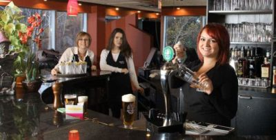 Bar tender serving beer